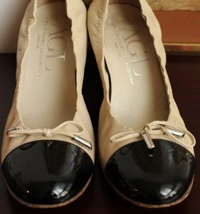 Black toe and beige pumps